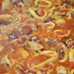Paella Ajouter le riz et de l'eau