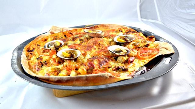 Pizza fruits de mer Terminer