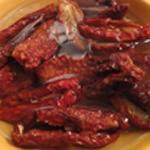 Tajine de joues de porc Ajouter les tomates séchées