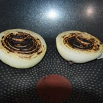 Consommé de langoustines Griller l'ognon